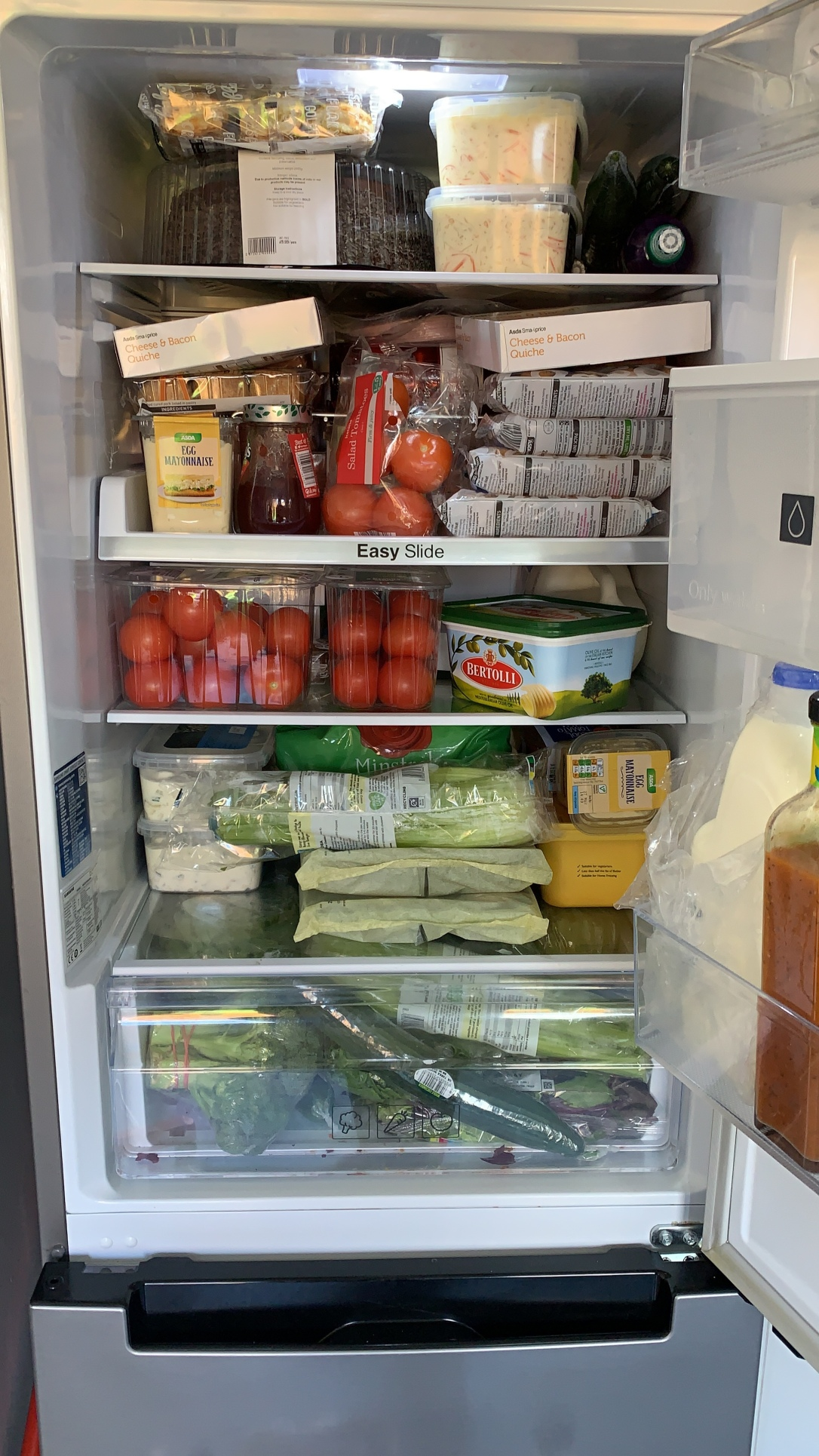 Extremely full fridge of food for the party