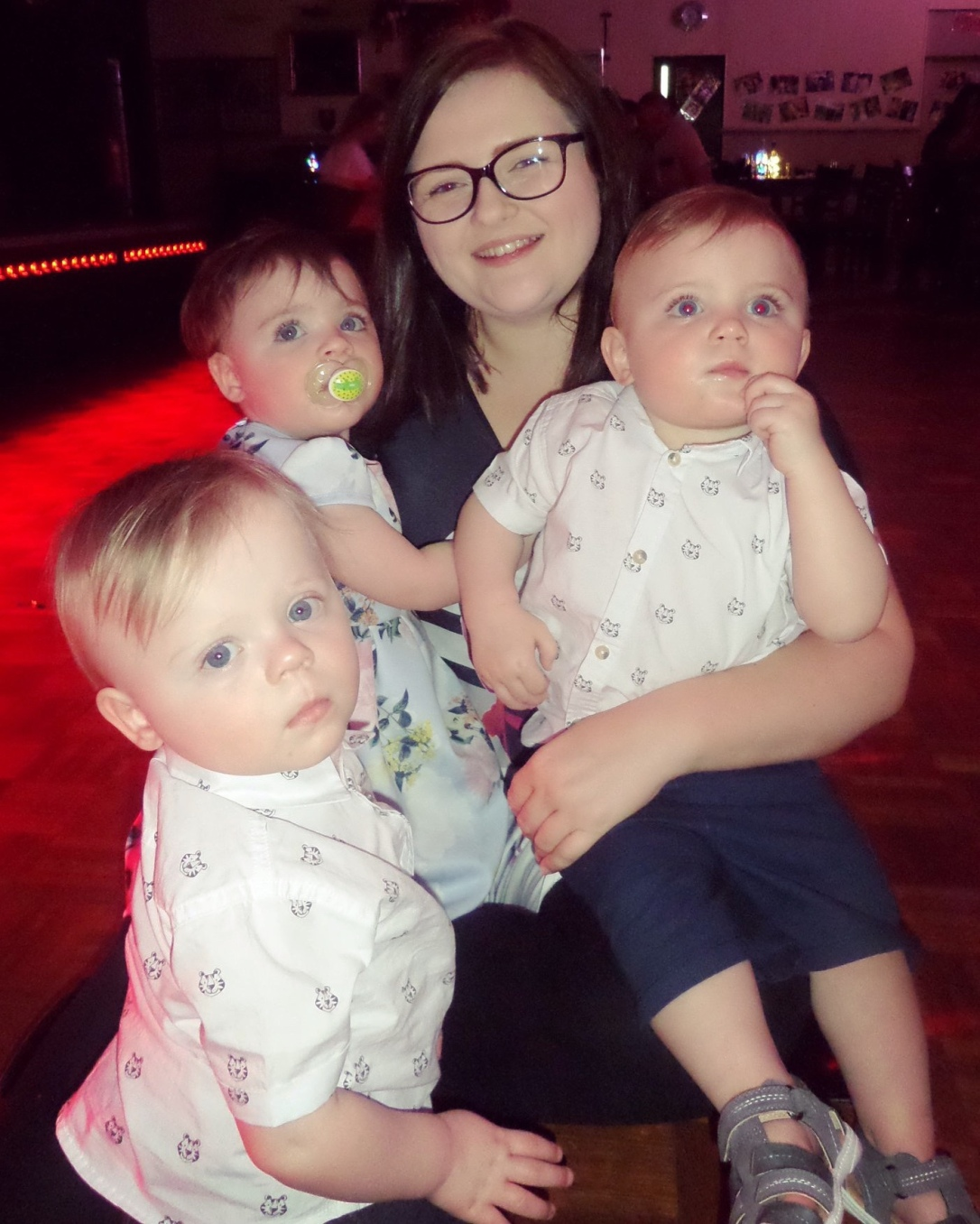Nicola sat on the dance floor with Oliver, Mila and Joshua sat on her.