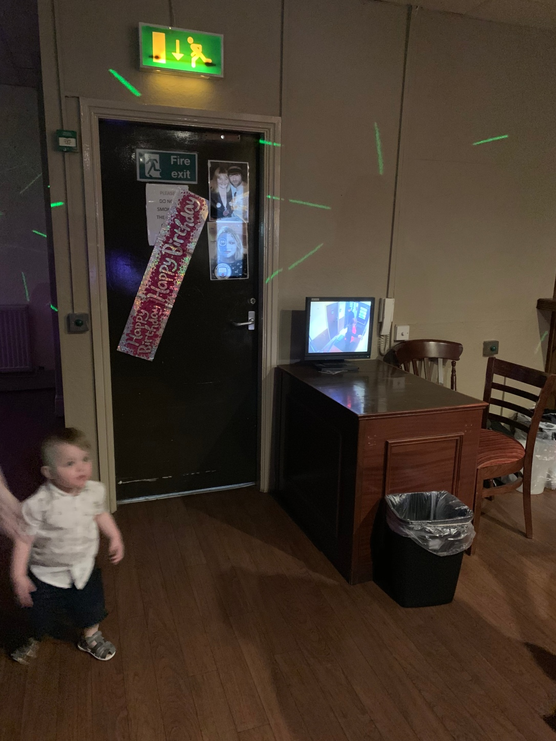 Joshua walking towards his mum, while we can see the birthday girl arriving on the security camera