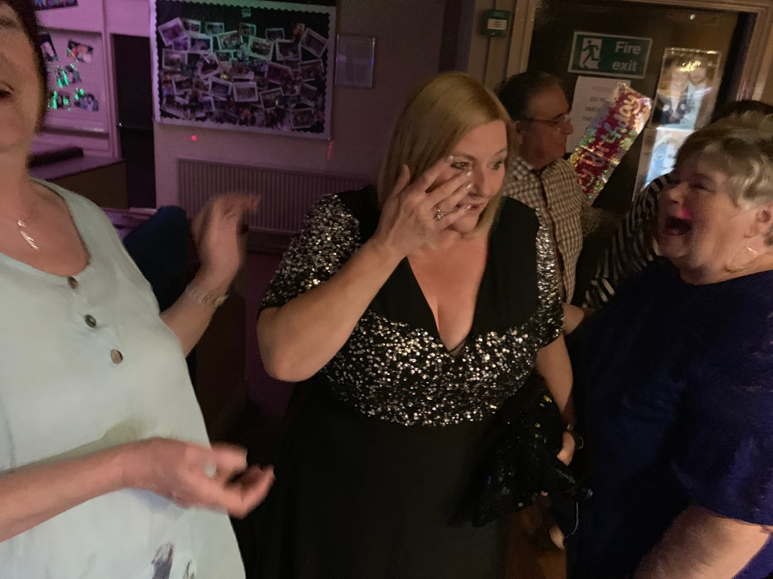 Nicola's mum crying in shock at just finding out she was at her surprise birthday party